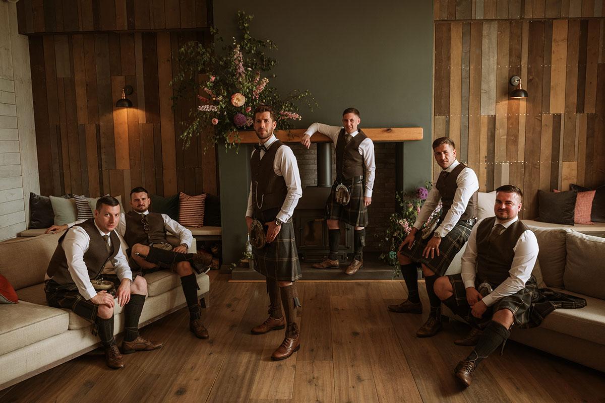 groom-and-groomsmen-in-brown-kilt-outfits