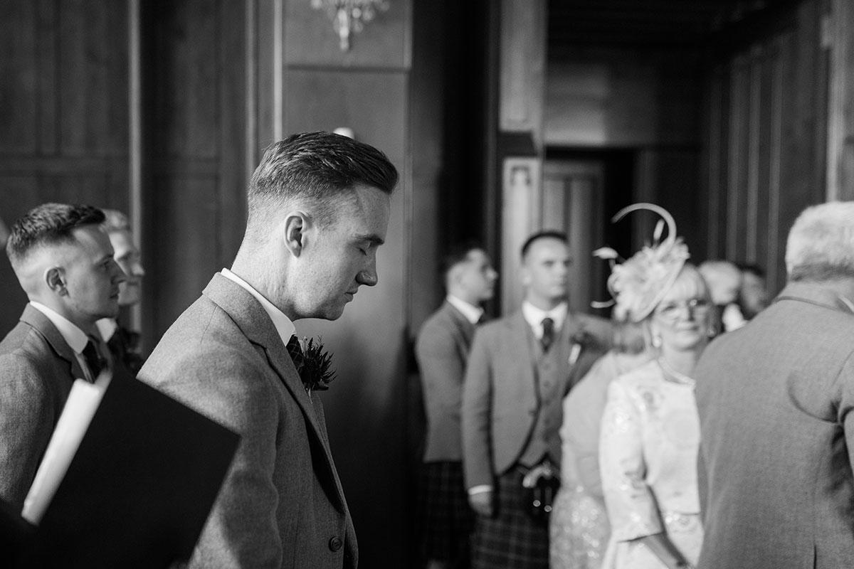 groom-waiting-on-bride-walking-down-aisle