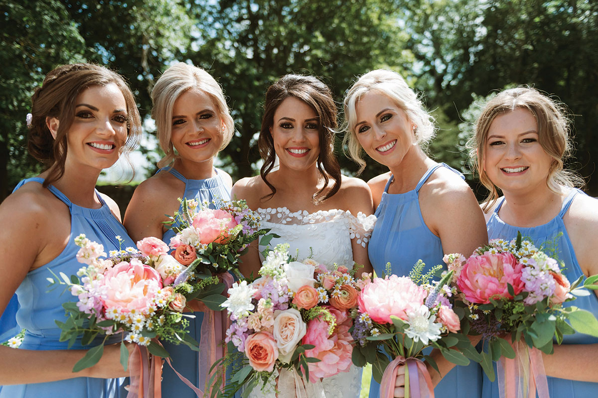bride-and-bridesmaids-in-pastel-blue-dresses