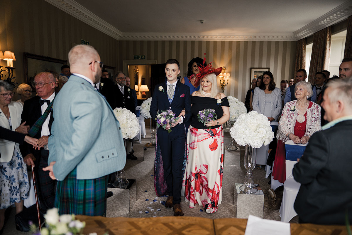 groom-walking-up-the-aisle-with-his-mum