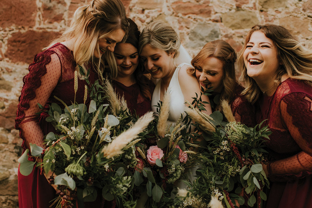 bridesmaids-with-bride-and-lush-bouquets