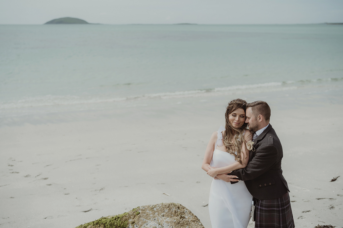 bride-and-groom-next-to-clear-water
