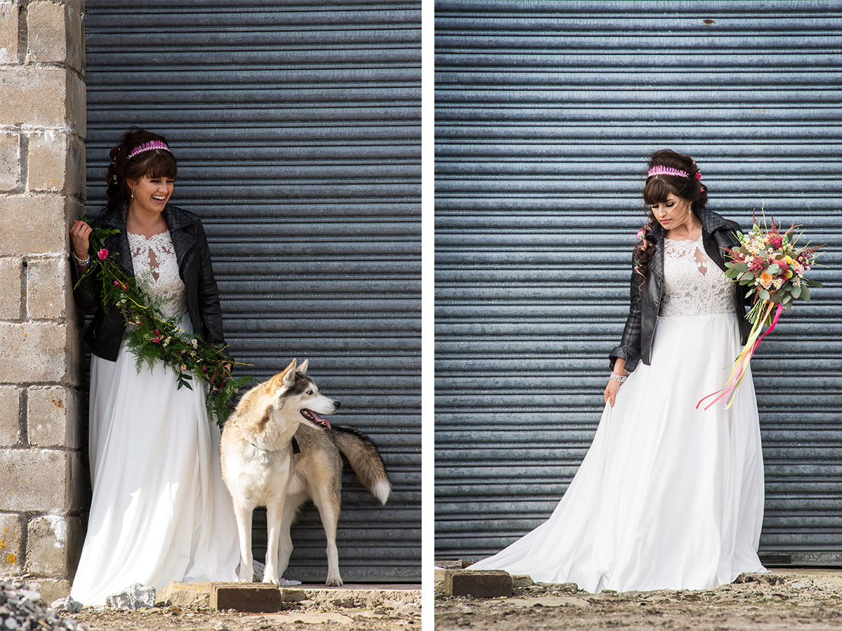 bride-in-leather-jacket-against-shutters-with-large-dog