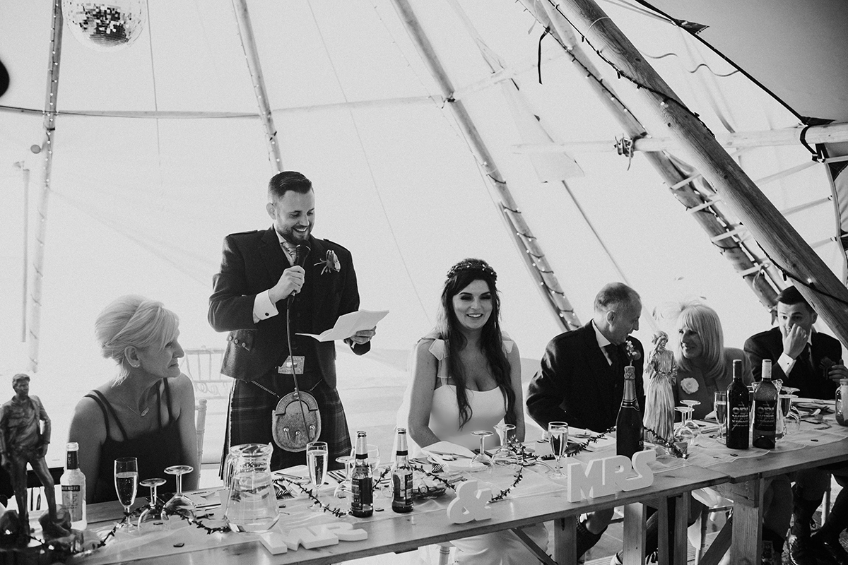 groom-giving-speech-in-teepee