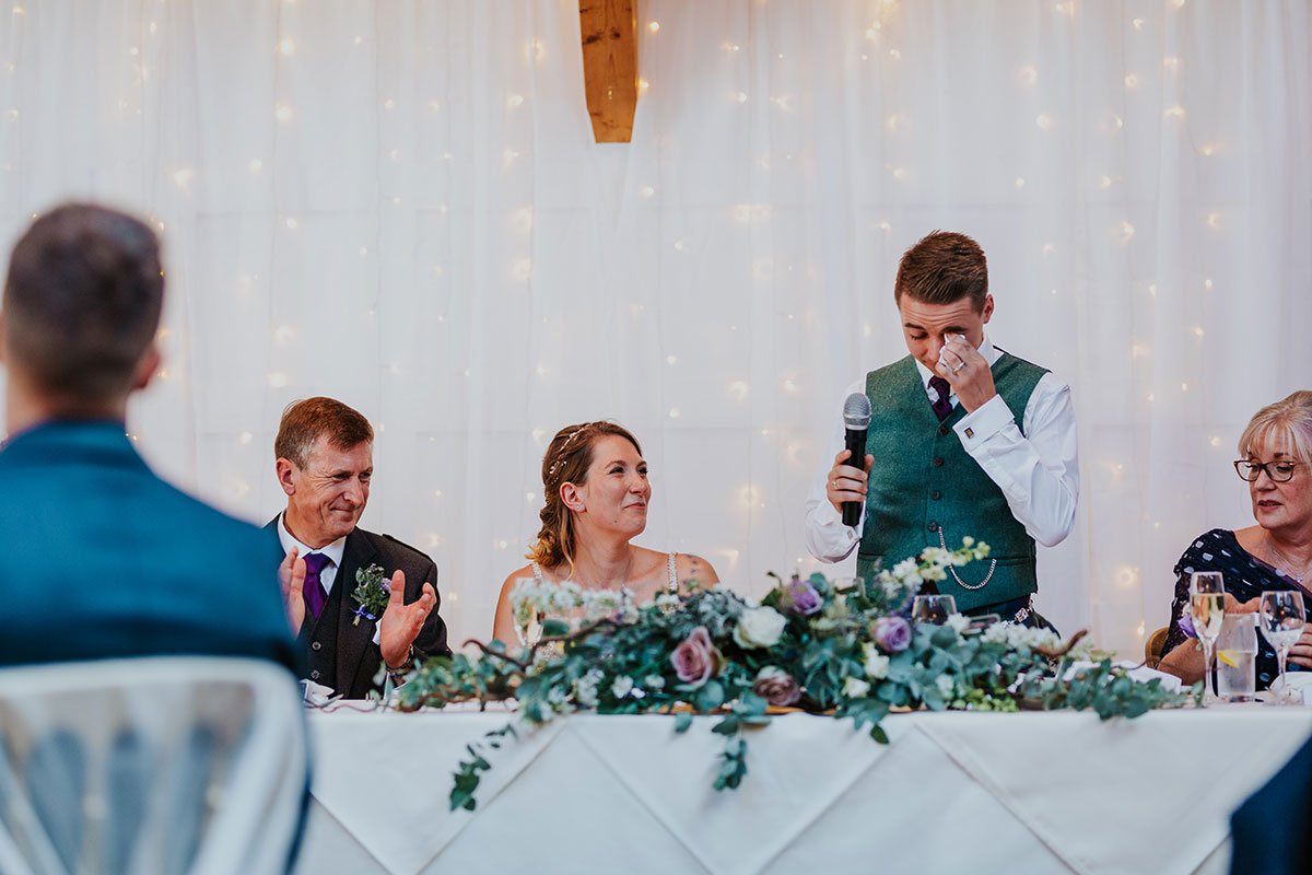 groom-wiping-tear-away-during-speeches