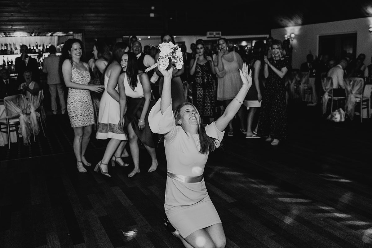 wedding-guest-celebrating-after-catching-bouquet