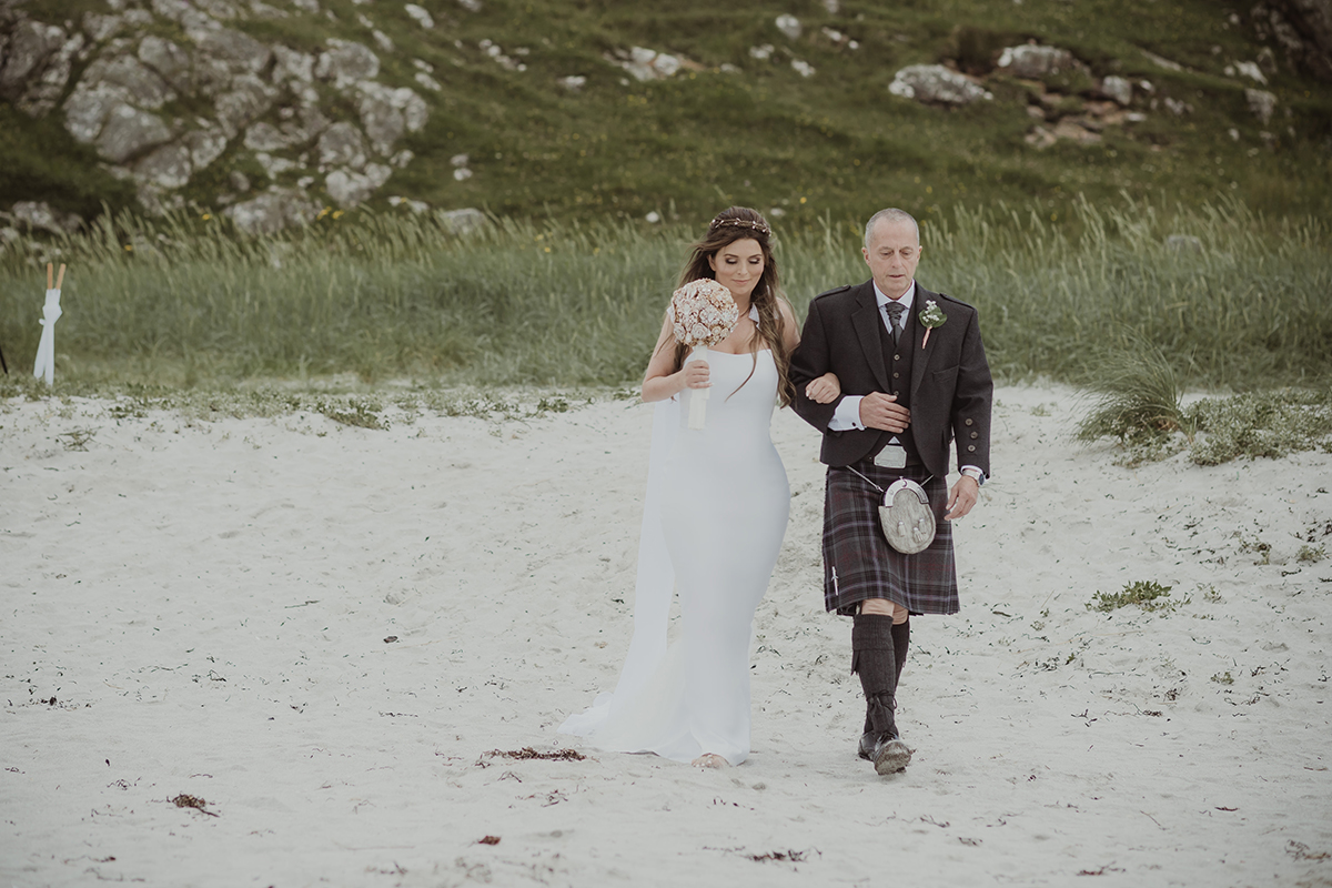 father-of-the-bride-and-bride-walking-down-the-aisle