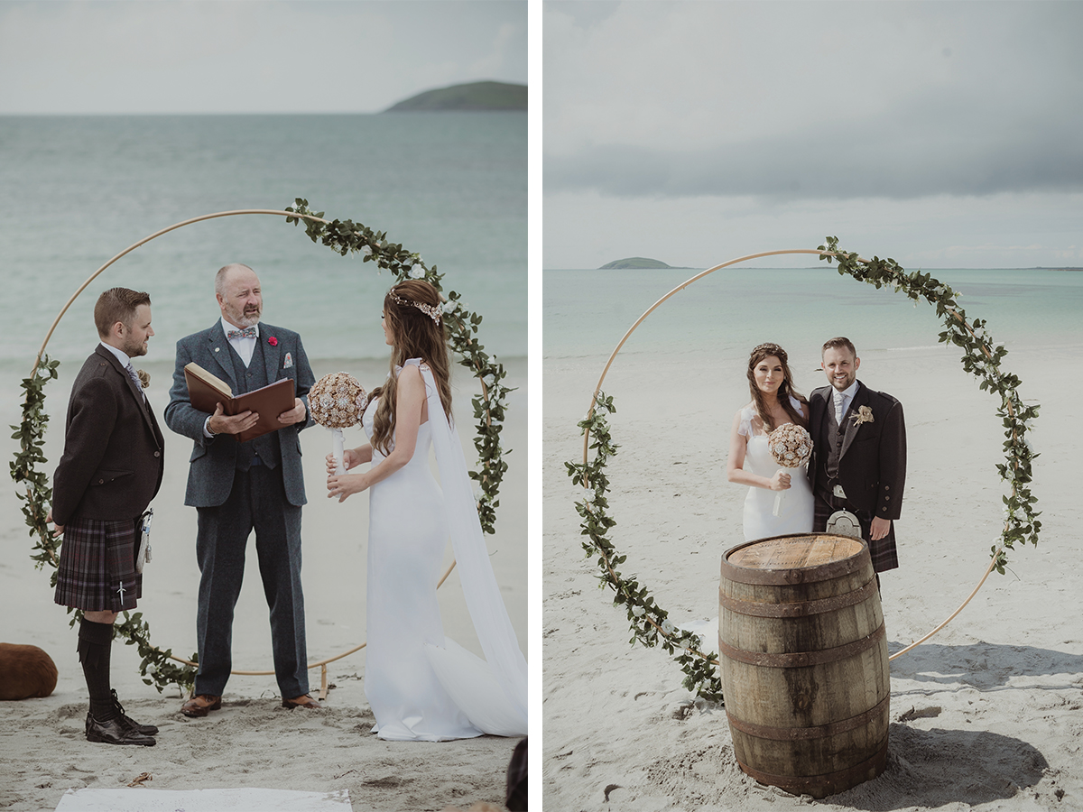bride-and-groom-on-beach-in-front-of-circle-arch