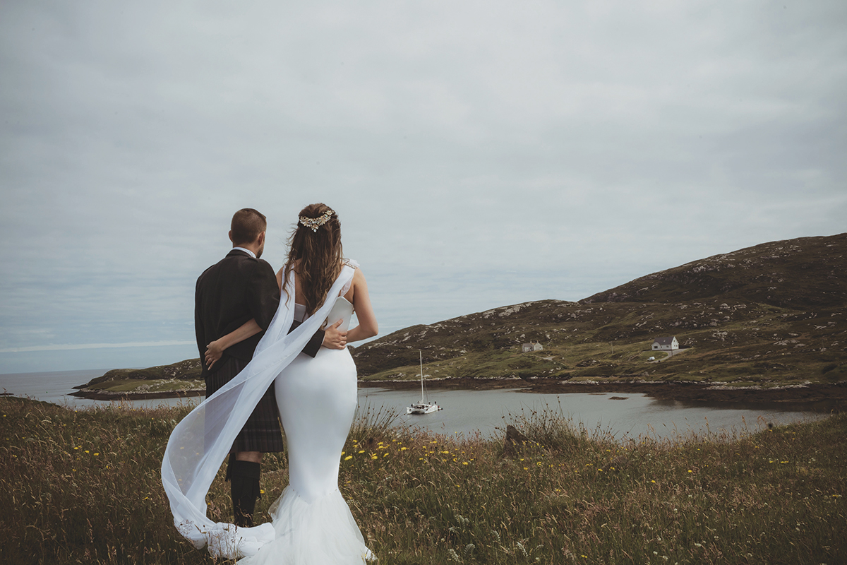 bride-and-groom-looking-over-the-bay