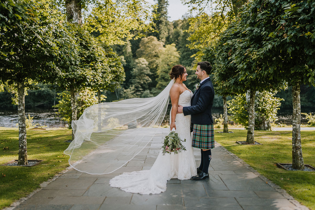 couple-standing-on-path-to-water-at-dunkeld-house