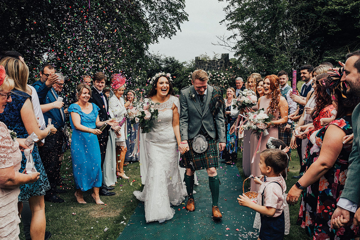 guests-throwing-confetti-on-the-newlyweds