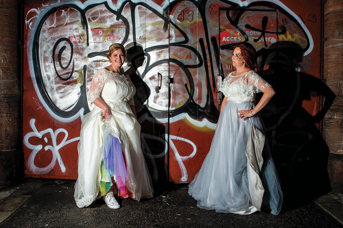 bride-with-rainbow-petticoat-in-front-of-grafitti