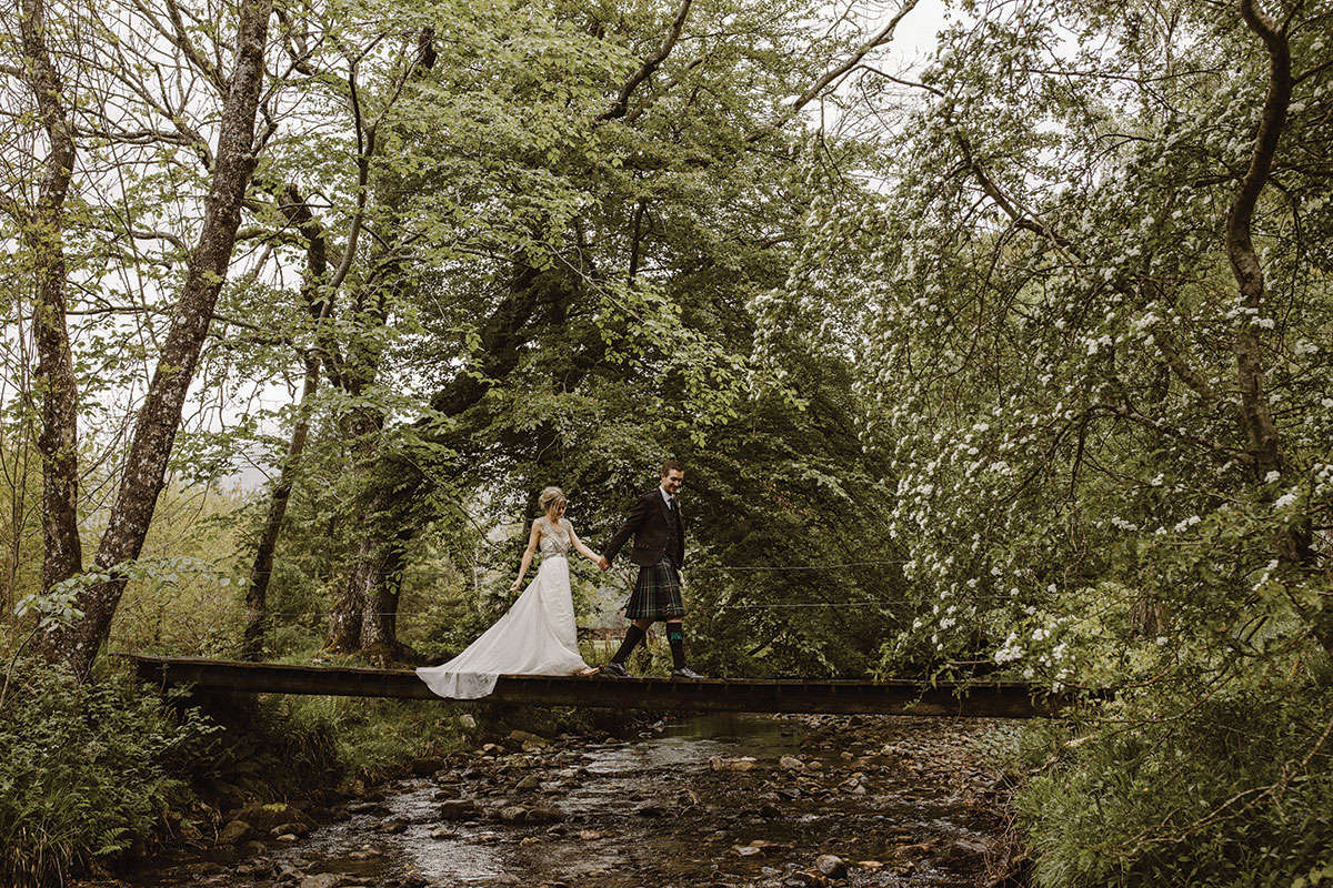 bride-and-groom-walking-across-a-bridge