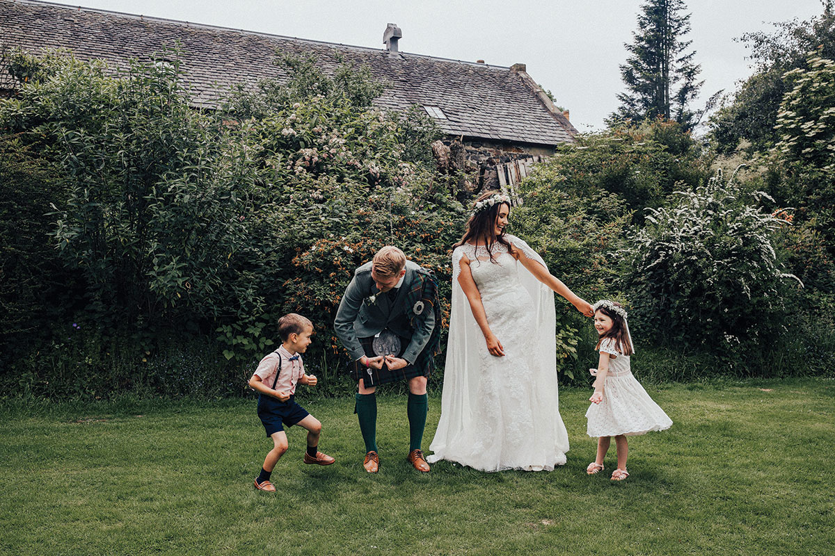 the-couple-playing-with-the-page-bou-and-flower-girl
