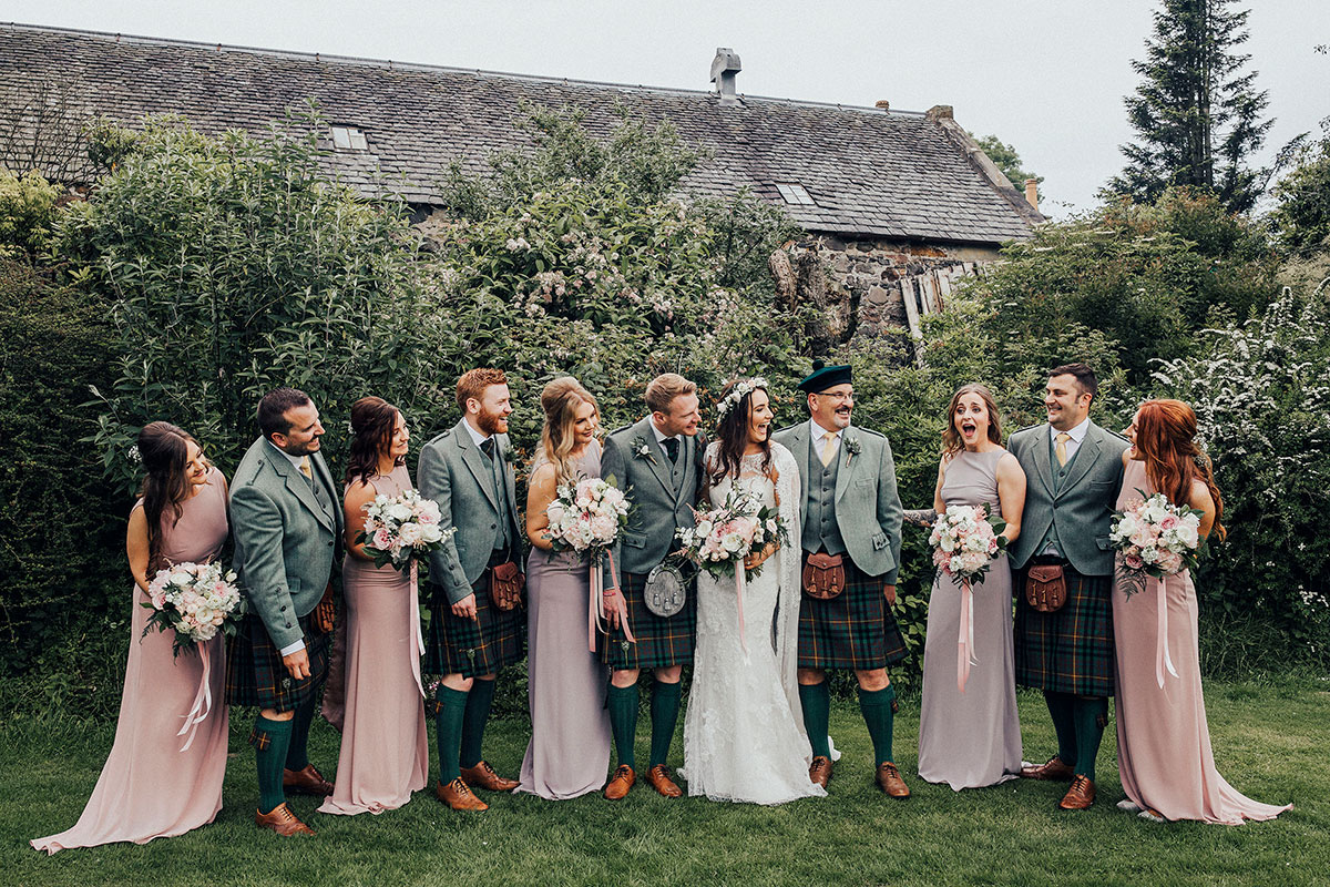 bridal-party-with-kilt-outfits-and-pastel-dresses