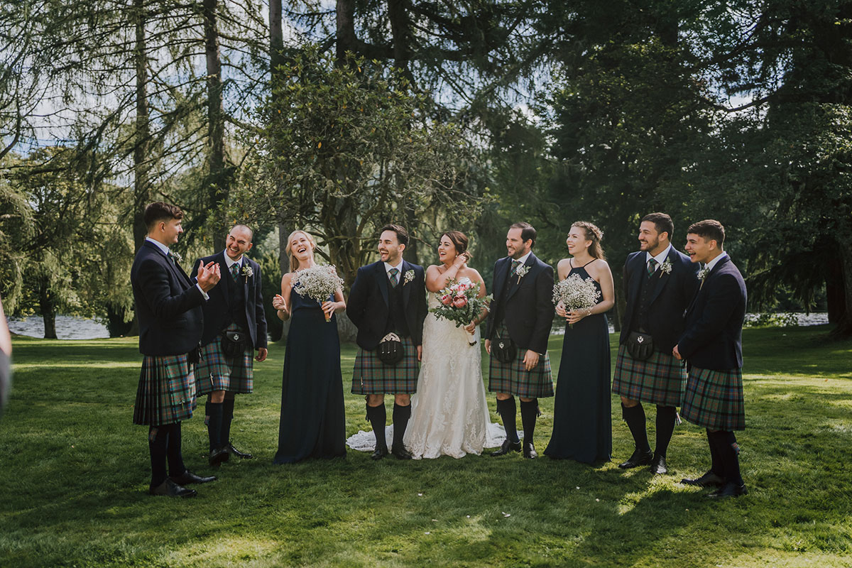 bridesmaids-in-navy-dresses-with-grooms-in-kilt-outfits