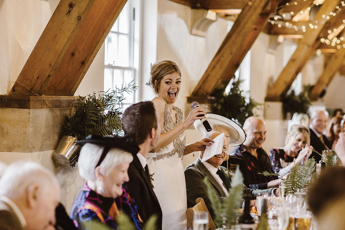 bride-laughing-giving-a-speech