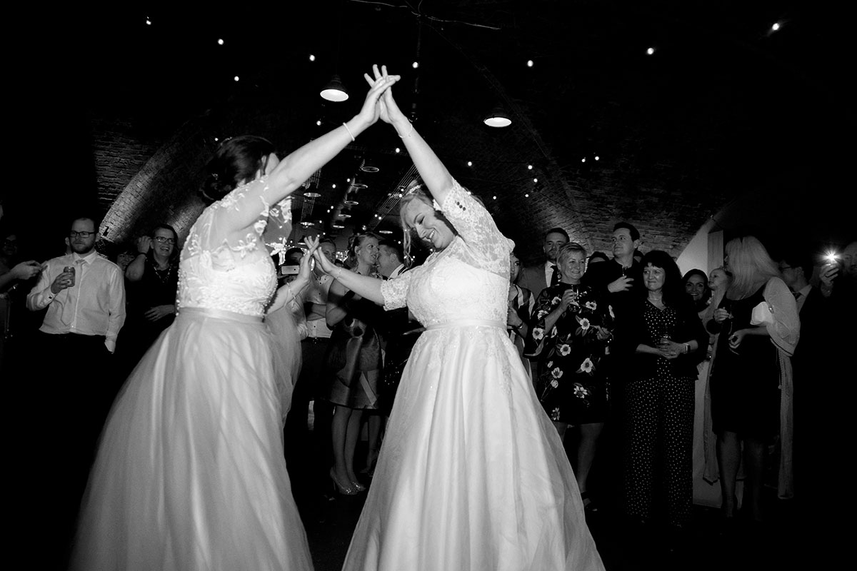 black-and-white-photo-of-brides-dancing