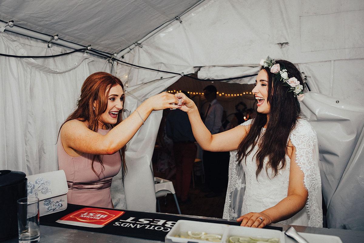 bride-and-bridesmaid-drinking-shot