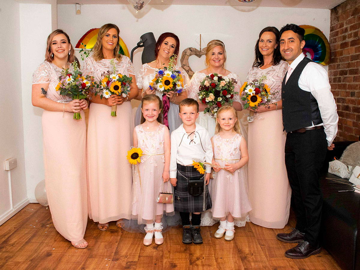 wedding-party-with-bridesmaids-in-peach-bridesmaids-dresses