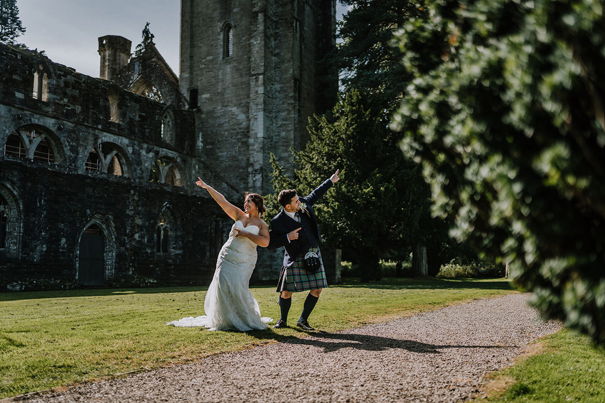 bride-and-groom-dancing-on-grounds-of-cathedral