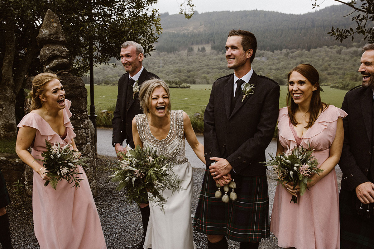 bride-laughing-with-the-bridal-party