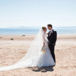 bride-and-groom-embracing-on-beach