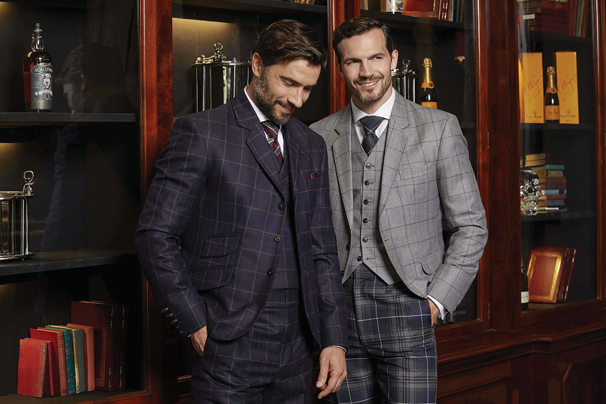 two men wearing checked suits