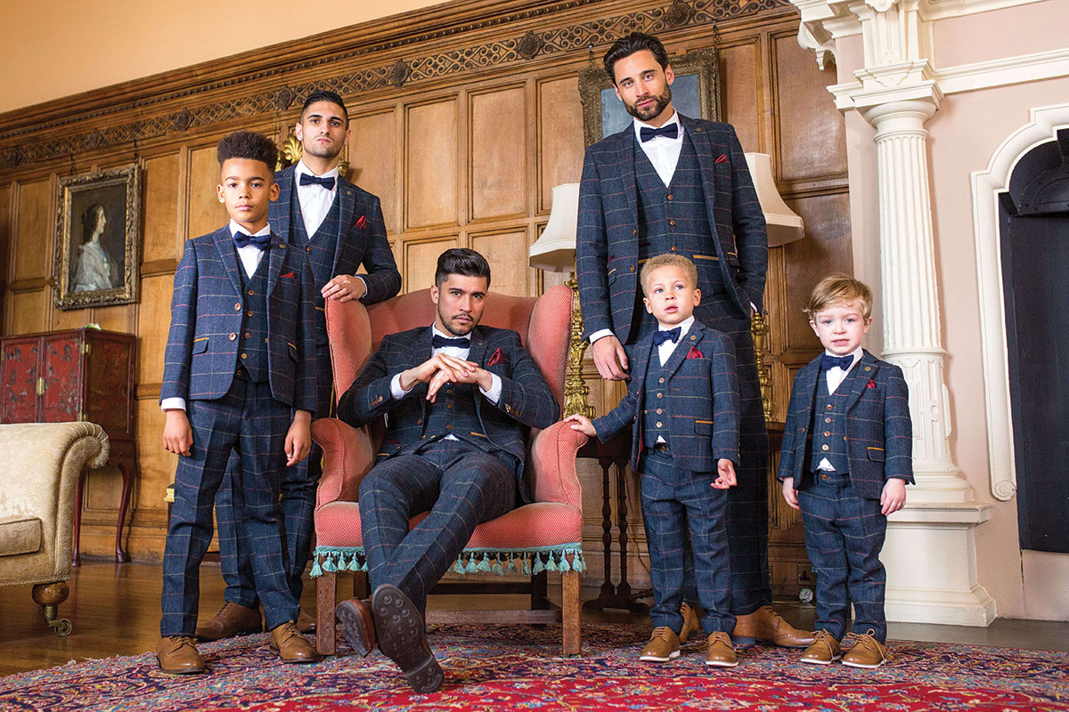 men and boys wearing checked suits and bow ties
