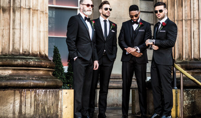 men wearing black suits and sunglasses