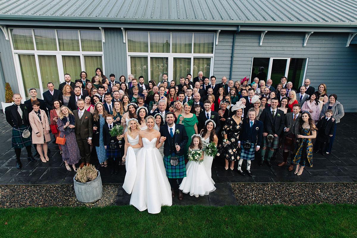 wedding-group-photo-barn-at-barra-castle