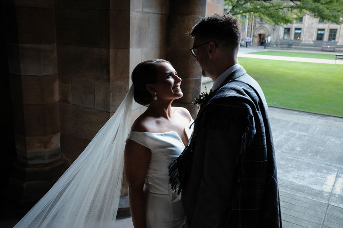 couple-looking-in-each-others-eyes-at-glasgow-university
