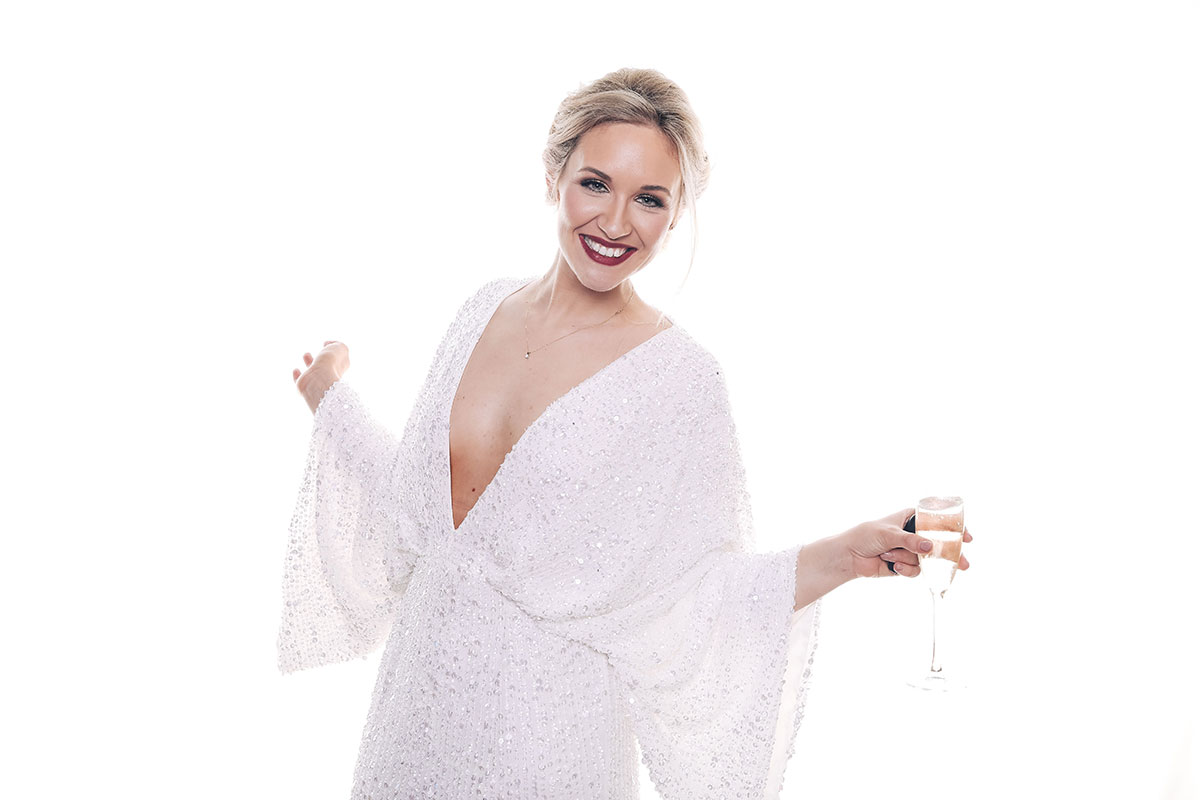 bride-champagne-in-photobooth-wearing-sparkly-dress