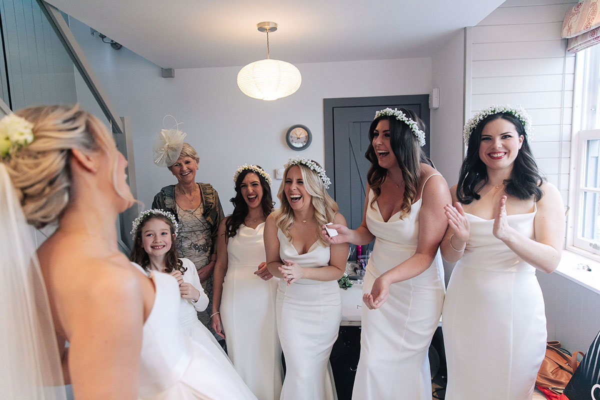 ride-mother-of-bride-bridesmaids-seeing-bride-first-time