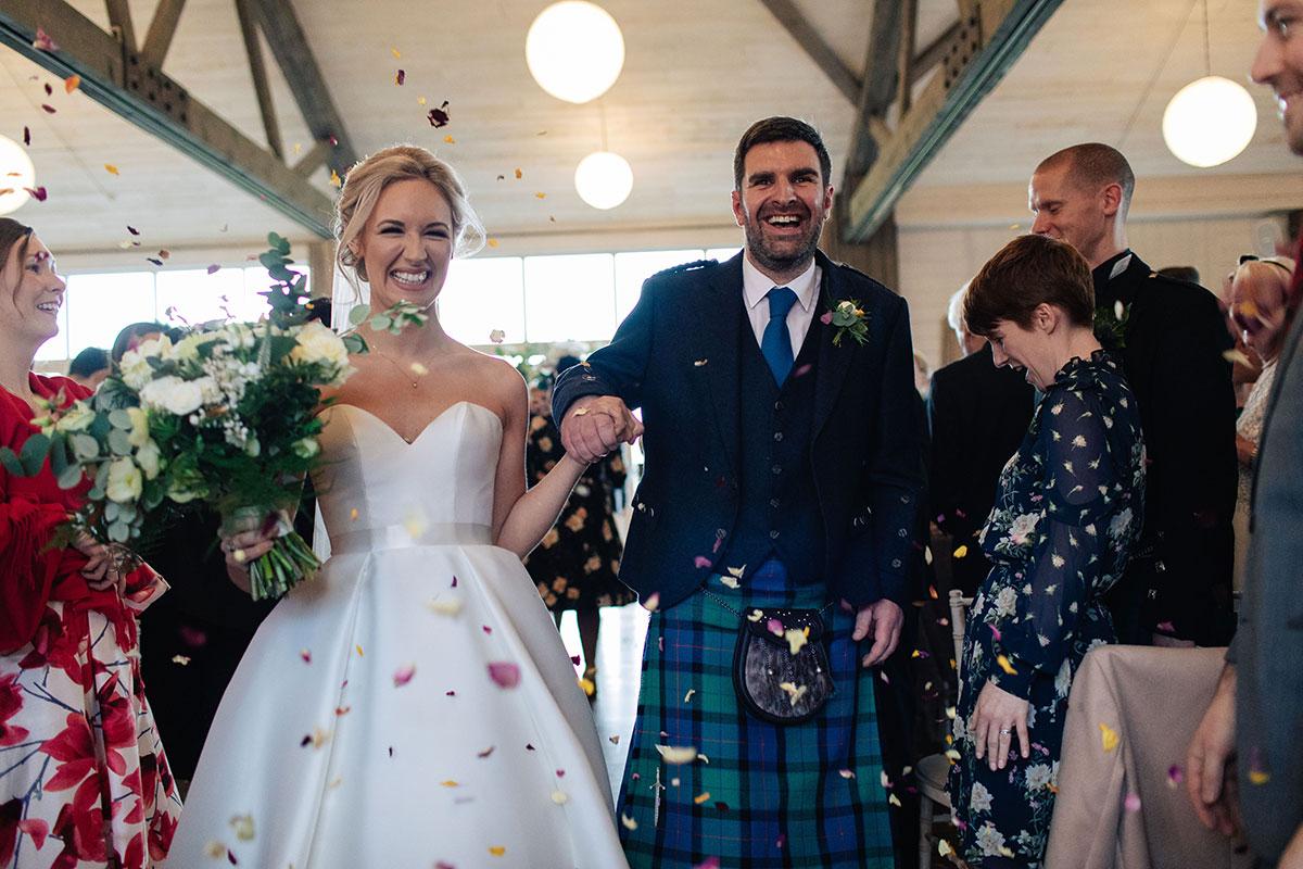 bride-groom-confetti-barn-at-barra-castle