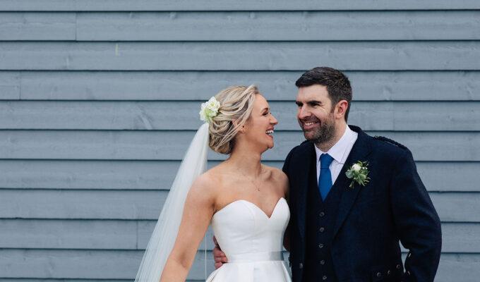 _bride-groom-outside-barn-at-barra-castle