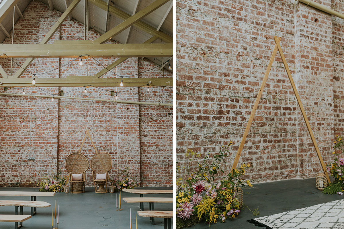 weaving-shed-dundee-ceremony-set-up-peacock-chairs-with-wooden-a-frame-and-flowers