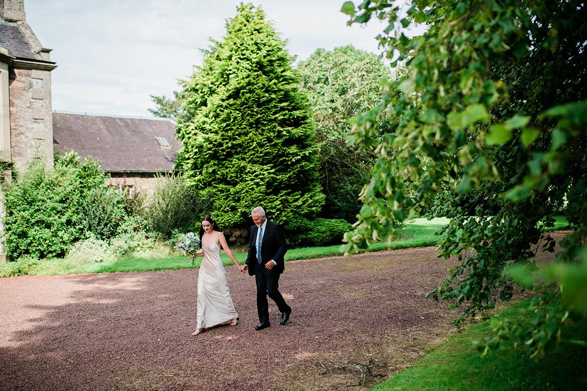 cormiston farm wedding mirrorbox photography bride walking with dad
