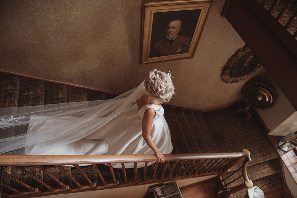 Aboyne Photographics Meldrum House Aberdeen wedding venue bride walking down stairs