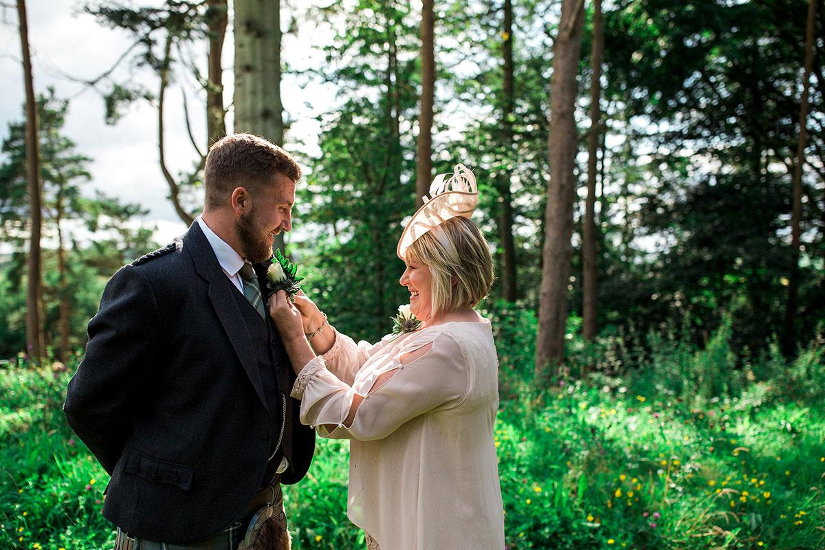 Hemera Visuals mum sorting grooms buttonhole