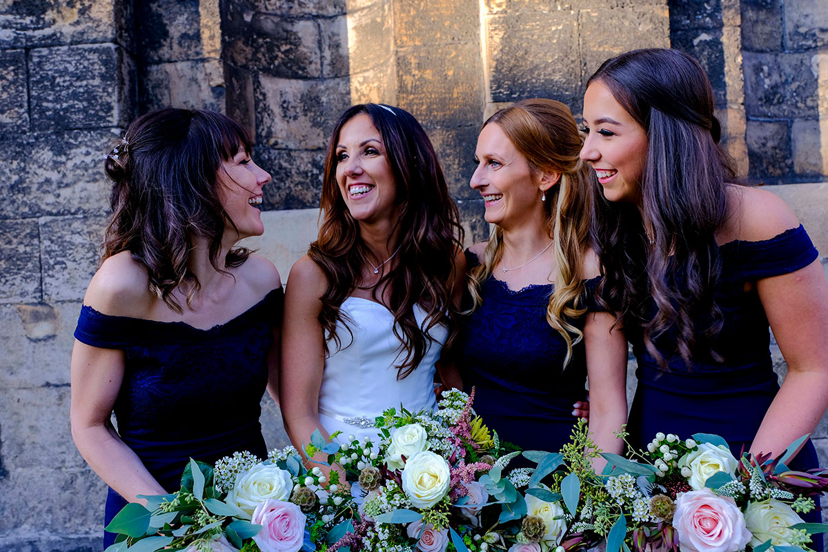 bride-with-bridesmaids-wearing-navy-blue