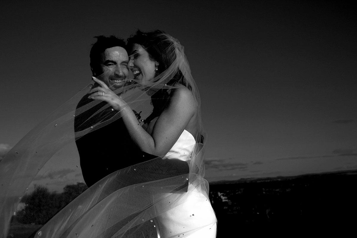 bride-groom-laughing-windy-veil-calton-hill
