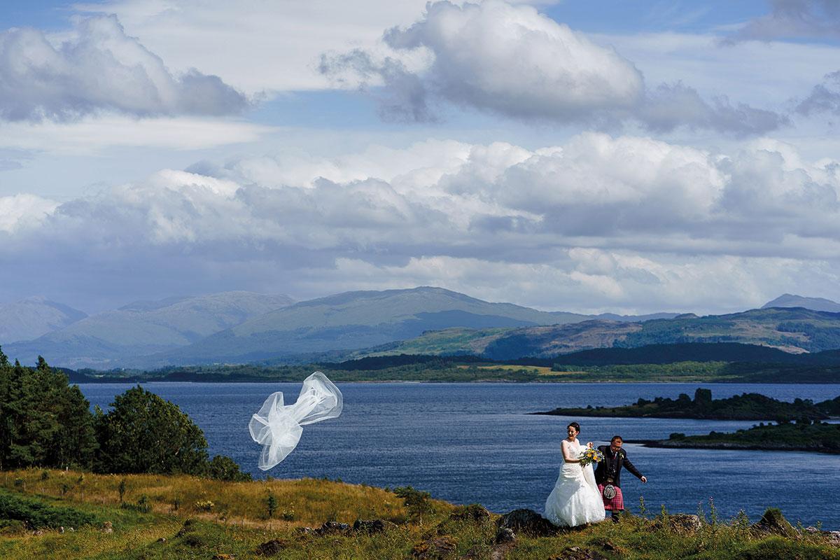 Isle-of-Lismore-Wedding-Photography-Barry-Robb-bride-groom-veil-blowing-away