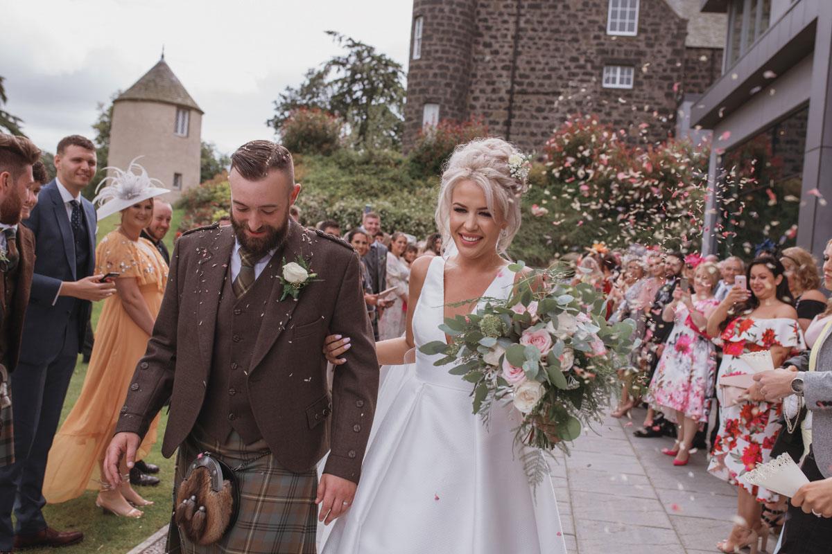 Aboyne Photographics Meldrum House Aberdeen wedding venue bride groom guests throwing confetti