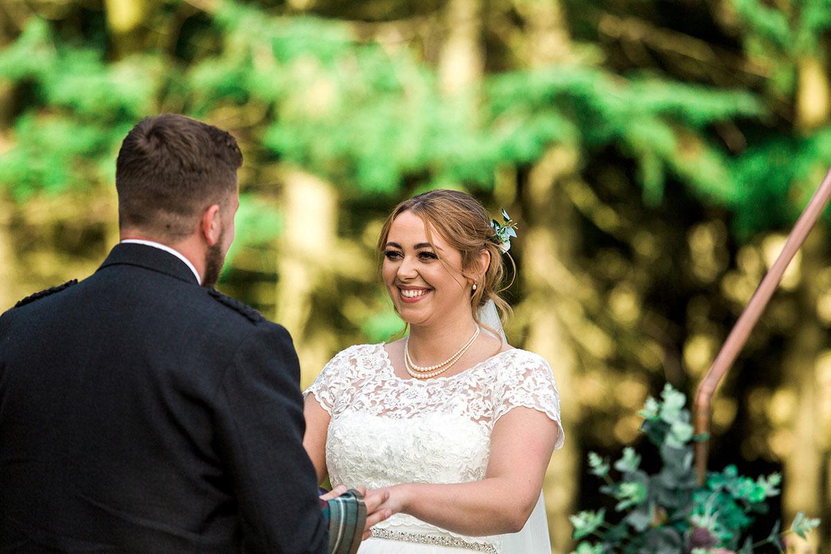 Hemera Visuals Dalswinton wedding ceremony smiling bride