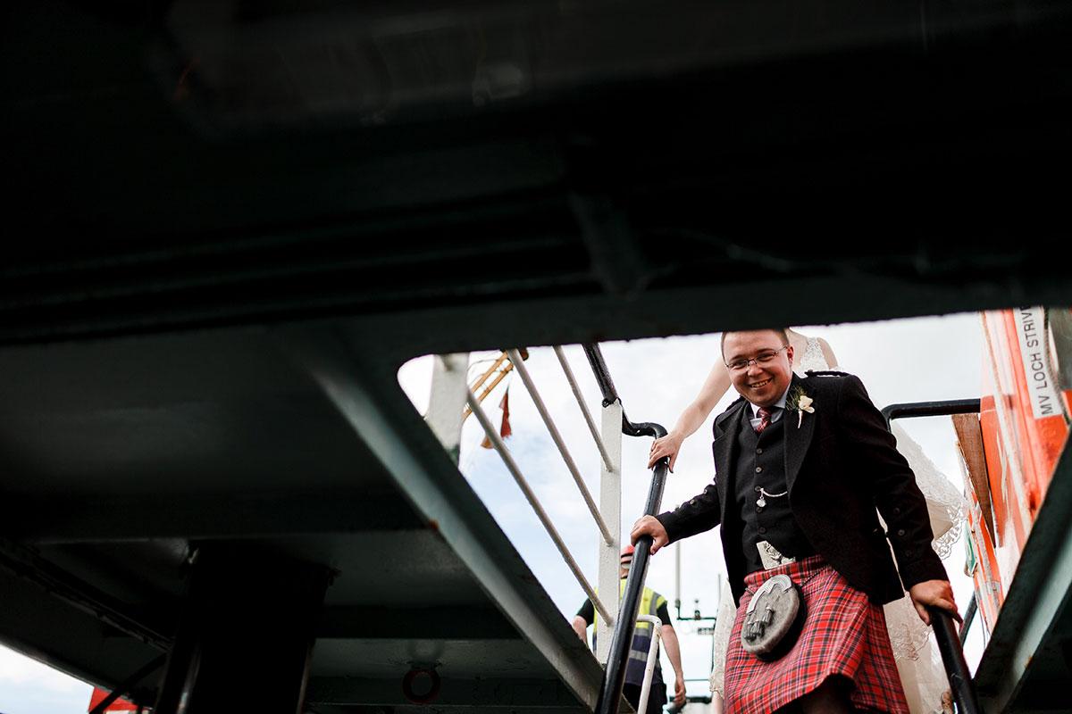 Isle-of-Lismore-Wedding-Photography-Barry-Robb-groom-on-ferry