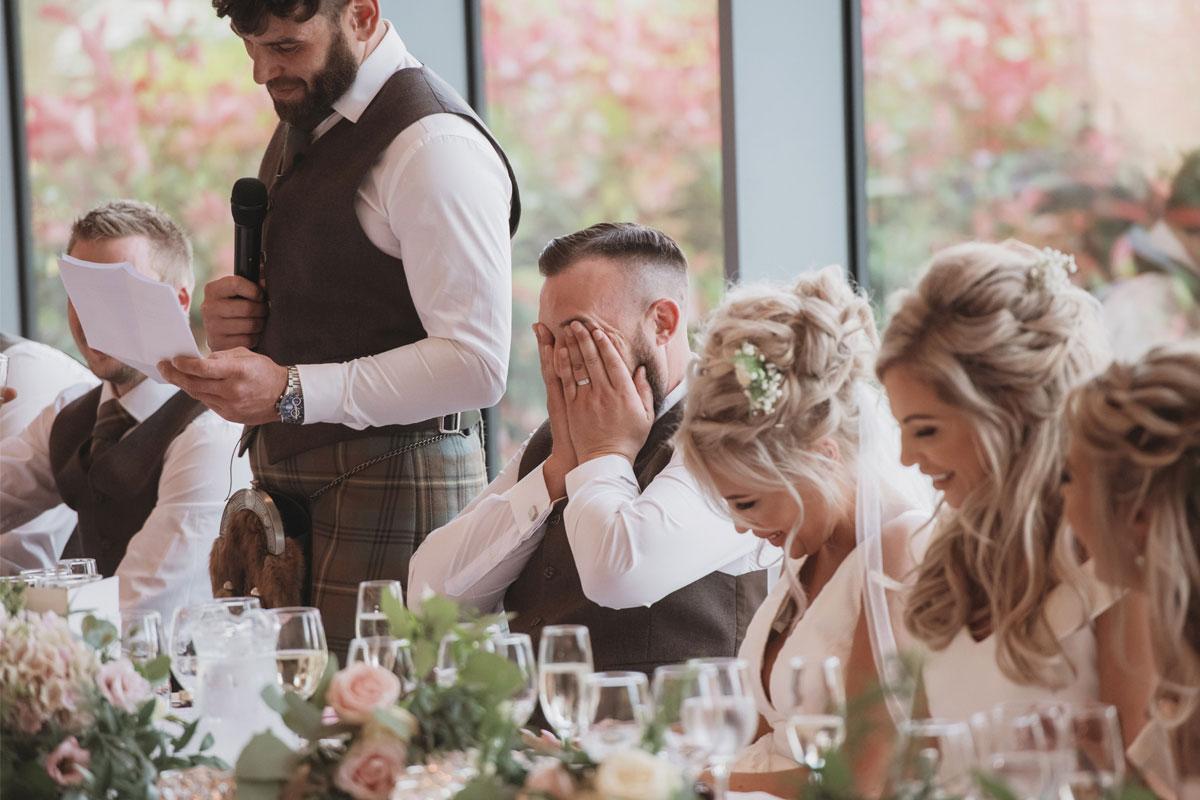 Aboyne Photographics Meldrum House Aberdeen wedding venue groom cringing during best man's speech