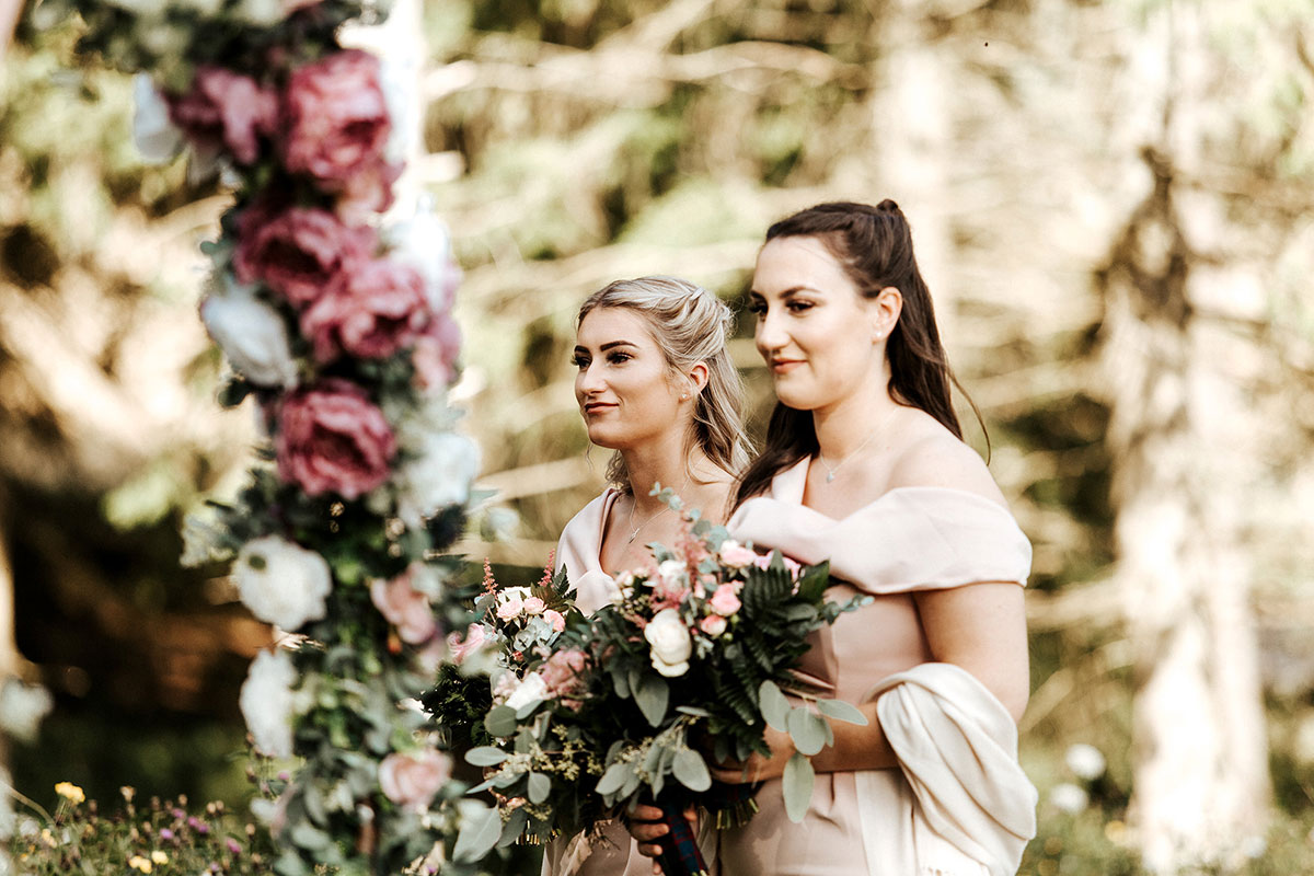 Hemera Visuals Dalswinton wedding two bridesmaids carrying bouquets