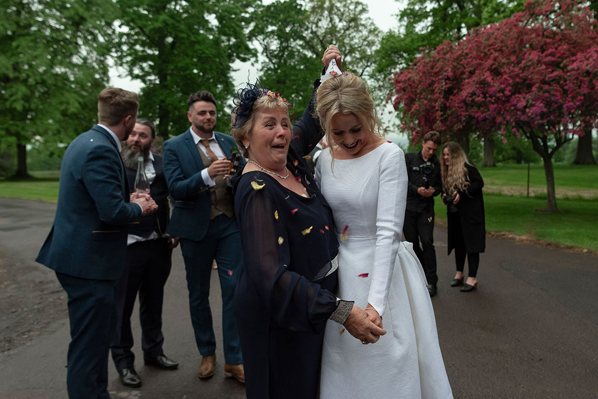 bride-confetti-pour-over-female-guest
