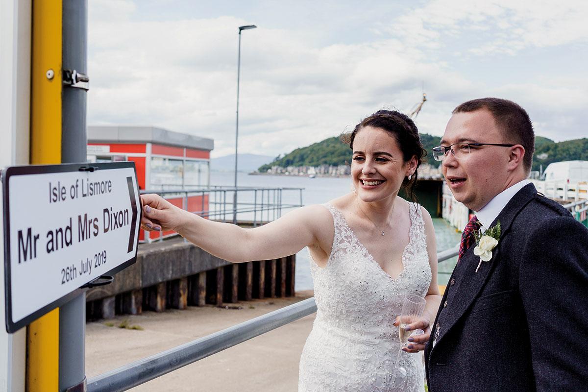 Isle-of-Lismore-Wedding-Photography-Barry-Robb-oban-pier-wedding-sign